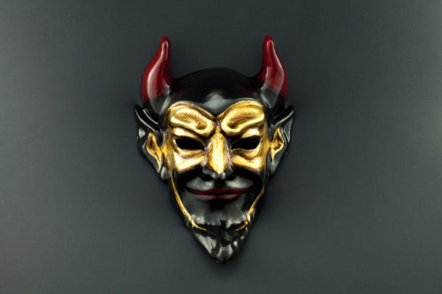 black devil with gold mask