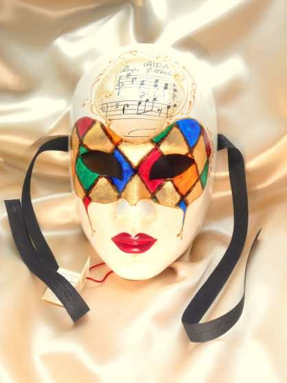 woman face with harlequin mask with music