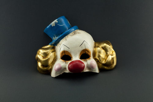 clown with gold leaf and blue hat