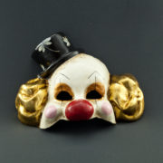 clown with gold leaf and black hat