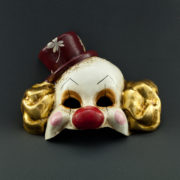 clown with gold leave and red hat
