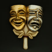tragedy comedy gold and silver with stick